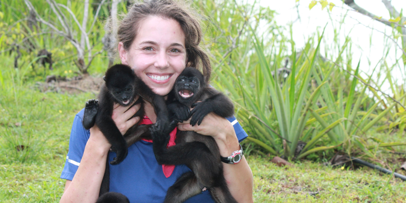Researcher with monkeys on shoulders