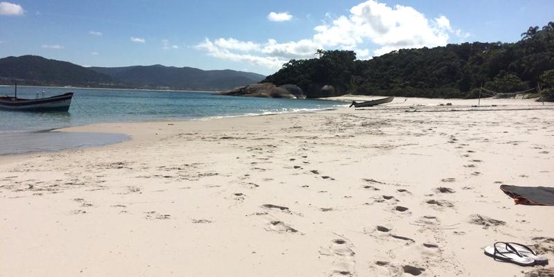 a pair of sandals on an empty brazilian beach
